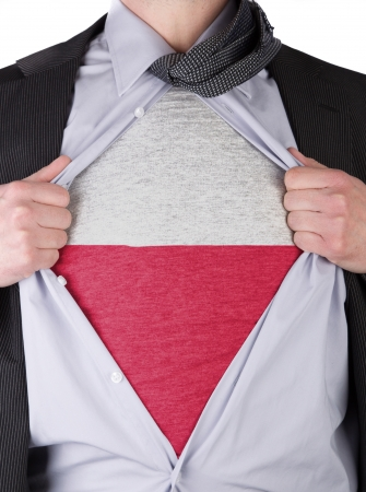Business man rips open his shirt to show his Polish flag t-shirt Stock Photo - 17541369