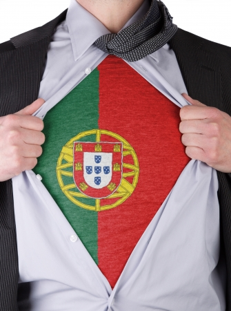 Business man rips open his shirt to show his Portuguese flag t-shirt Stock Photo - 17541364