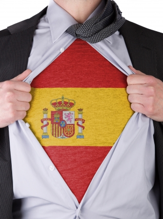 Business man rips open his shirt to show his Spanish flag t-shirt Stock Photo - 17541368