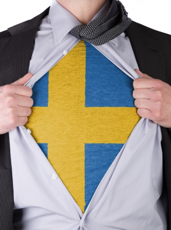 Business man rips open his shirt to show his Swedish flag t-shirt Stock Photo - 17541365