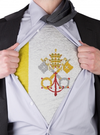 Business man rips open his shirt to show his Vatican City flag t-shirt Stock Photo - 17541374