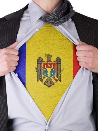 Business man rips open his shirt to show his Moldavian flag t-shirt Stock Photo - 17541382