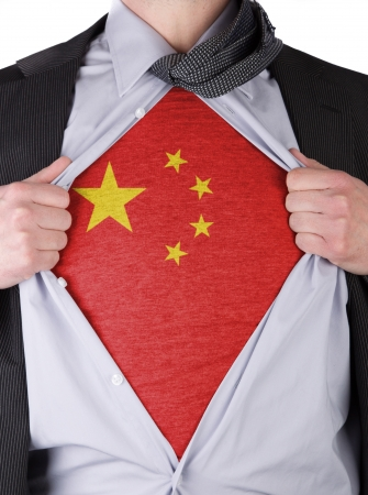 Business man rips open his shirt to show his Chinese flag t-shirt Stock Photo - 17541389