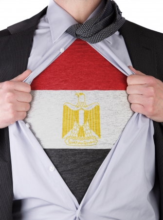 Business man rips open his shirt to show his Saudi Egyptian flag t-shirt Stock Photo - 17541384