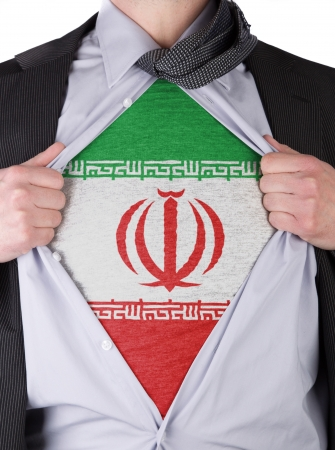 Business man rips open his shirt to show his iranian flag t-shirt photo