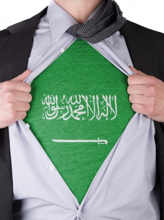 Business man rips open his shirt to show his Saudi Arabian flag t-shirt Stock Photo - 17541387