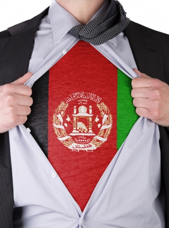 afghan flag: Business man rips open his shirt to show his Afghan flag t-shirt Stock Photo
