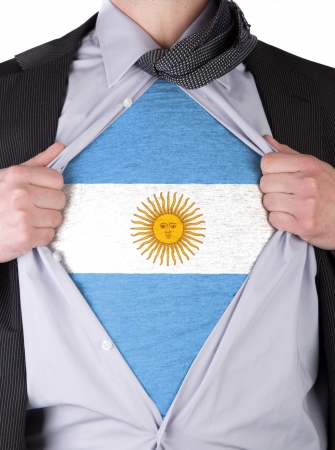 rips: Business man rips open his shirt to show his Argentinians flag t-shirt
