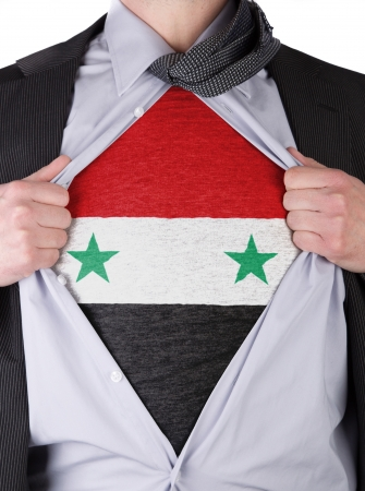 Business man rips open his shirt to show his Syrian flag t-shirt Stock Photo - 17670948