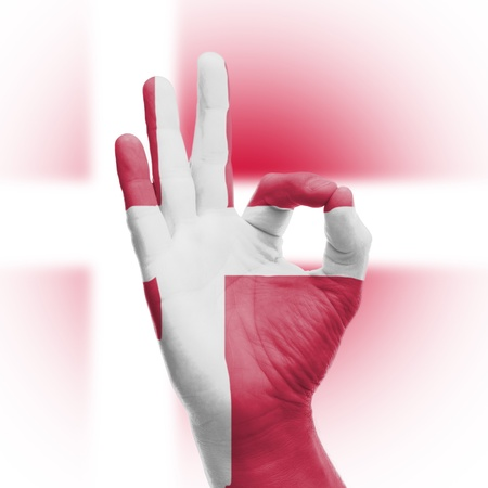 hand OK sign, wrapped in the flag of Denmark Stock Photo - 17670959