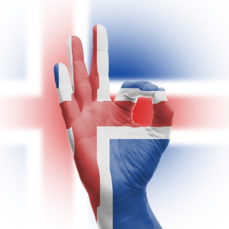 hand OK sign, wrapped in the flag of Iceland Stock Photo - 17670963