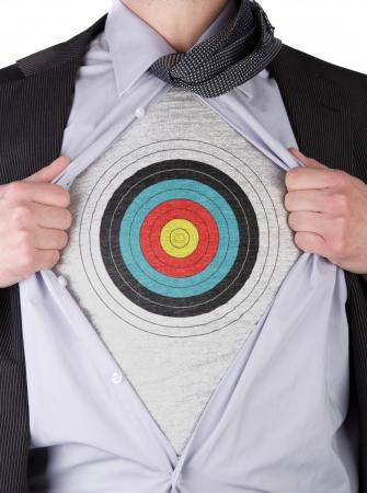 Business man rips open his shirt to show his bullseye sign t-shirt Archivio Fotografico
