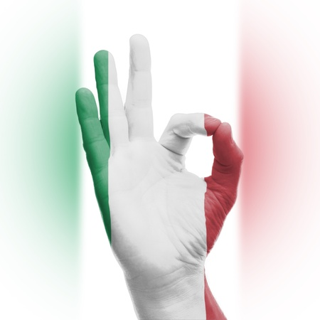 hand OK sign, wrapped in the flag of Italy photo