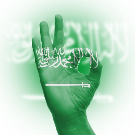 hand OK sign, wrapped in the flag of Saudi Arabia photo