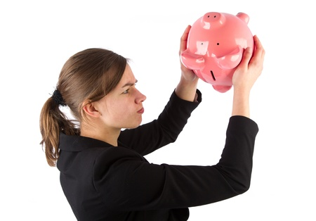 Business woman is unable to get money out of piggy bank photo