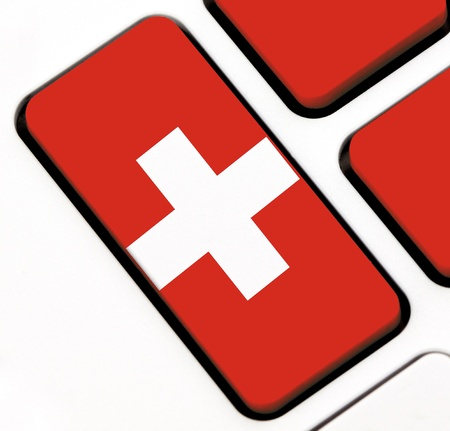 Keyboard keys with the Swiss flag painted on it photo