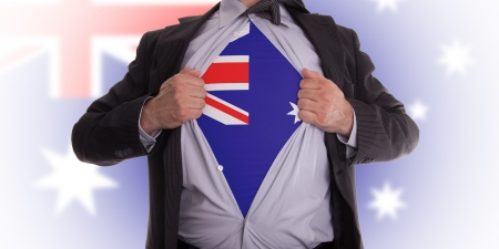Business man rips open his shirt to show his Australian flag t-shirt Stock Photo - 18232690