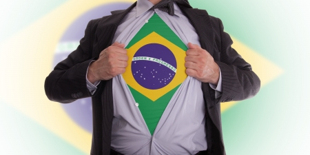 Business man rips open his shirt to show his Brazilian flag t-shirt Stock Photo - 18232686