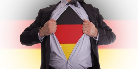 Business man rips open his shirt to show his German flag t-shirt Stock Photo - 18232673