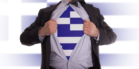 Business man rips open his shirt to show his Greek flag t-shirt Stock Photo - 18232668