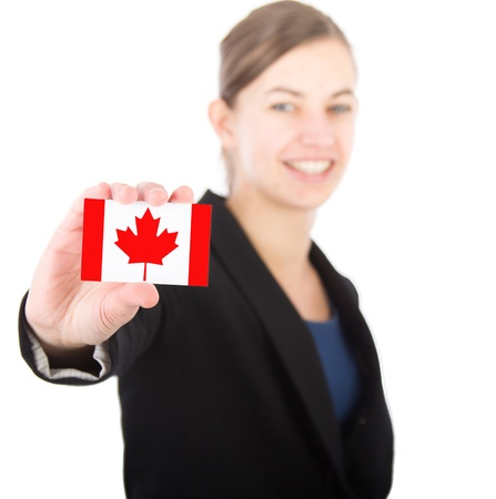 business woman holding a card with the Canadian flag. With focus on the card photo