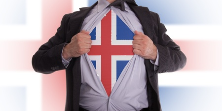 Business man rips open his shirt to show his Icelandic flag t-shirt Stock Photo - 18282126