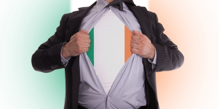 Business man rips open his shirt to show his Irish flag t-shirt Stock Photo - 18304996