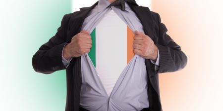 Business man rips open his shirt to show his Irish flag t-shirt Stock Photo - 18304996