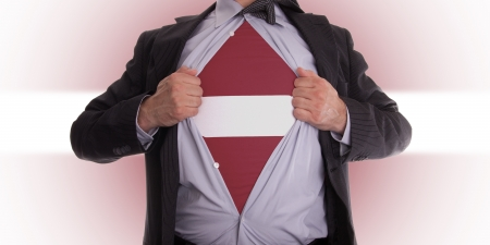 Business man rips open his shirt to show his Latvian flag t-shirt Stock Photo - 18305000
