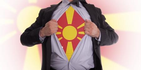 Business man rips open his shirt to show his Macedonian flag t-shirt Stock Photo - 18305001