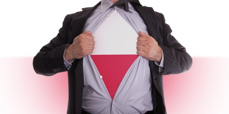 Business man rips open his shirt to show his Polish flag t-shirt Stock Photo - 18304995