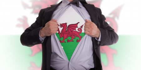 welsh flag: Business man rips open his shirt to show his Welsh flag t-shirt Stock Photo
