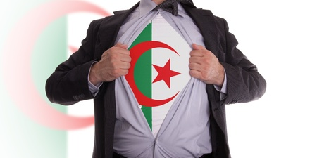 algerian flag: business man rips open his shirt to show his Algerian flag t-shirt