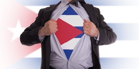 Business man rips open his shirt to show his Cuban flag t-shirt Stock Photo - 18358669