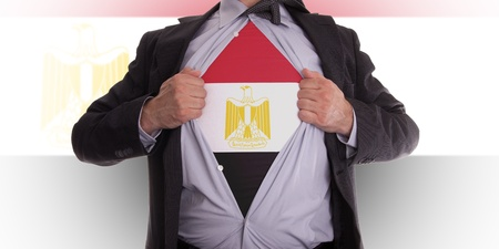 Business man rips open his shirt to show his Egyptian flag t-shirt photo
