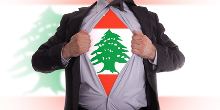 Business man rips open his shirt to show his Lebanese flag t-shirt Stock Photo - 18358667