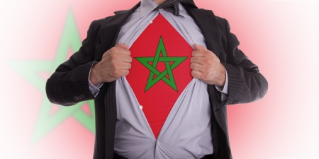 business man rips open his shirt to show his Moroccan flag t-shirt Stock Photo - 18358677