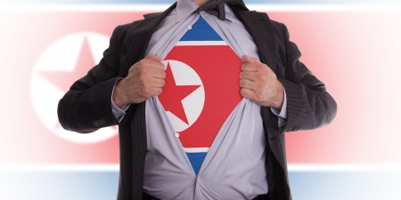 Business man rips open his shirt to show his North Korean flag t-shirt Stock Photo - 18358676