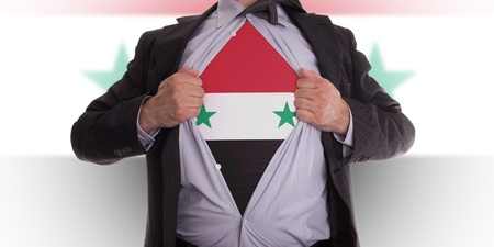 Business man rips open his shirt to show his Syrian flag t-shirt photo