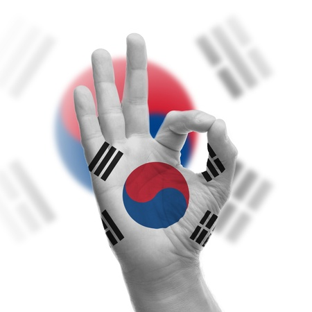 Hand OK sign, wrapped in the flag of South Korea