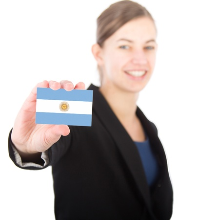 argentinian flag: business woman holding a card with the Argentinian flag. With focus on the card