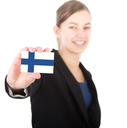 business woman holding a card with the Finnish flag. With focus on the card photo