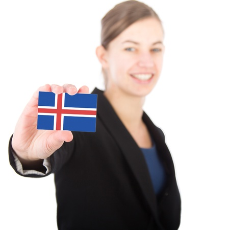 business woman holding a card with the Icelandic flag. With focus on the card photo