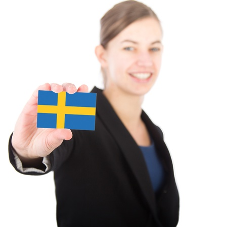 business woman holding a card with the Swedish flag. With focus on the card Stock Photo