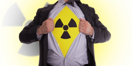 Business man rips open his shirt to show his radiation t-shirt Stock Photo - 18541559