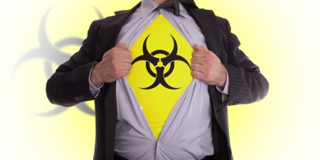 Business man rips open his shirt to show his biohazard symbol t-shirt Stock Photo