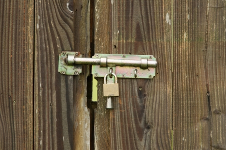 Padlock on a wooden door photo