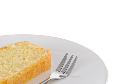 One slice of fresh homemade butter cake and a fork on a white plate with room for copy space Stock Photo - 20358347