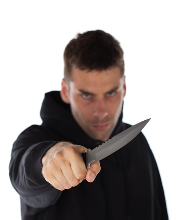 Man threatening with a large knife isolated on white photo