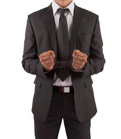Businessman in suit and handcuffs isolated on white photo